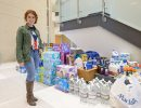 Ly Velez with donations for Puerto Rico